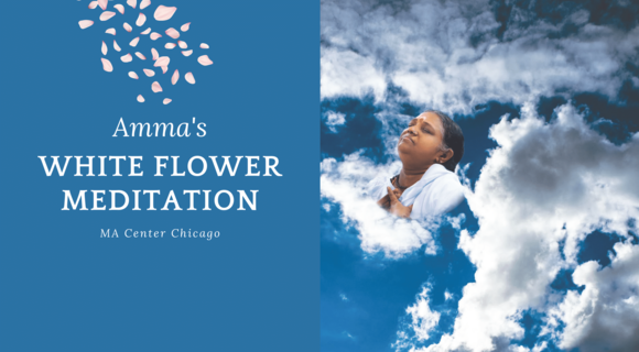 An image of Amma surrounded by white clouds