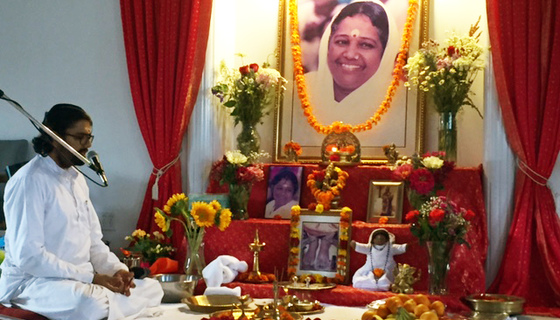 Br. Ramanand sitting before beautiful altar
