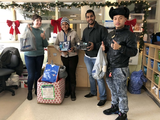AYUDH volunteers dropping off items donated during their Holiday Gift Drive to Youth Without Shelter