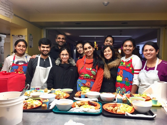 Group photo of youth and adults with trays of food