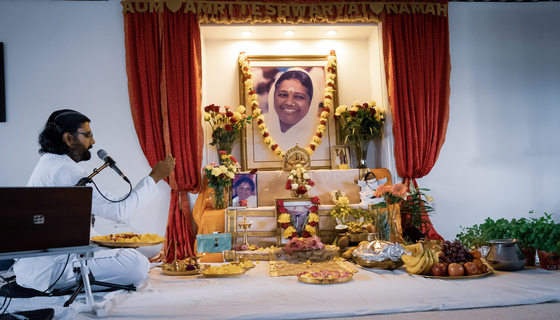 Ramanand in front of Vishu altar with seedlings