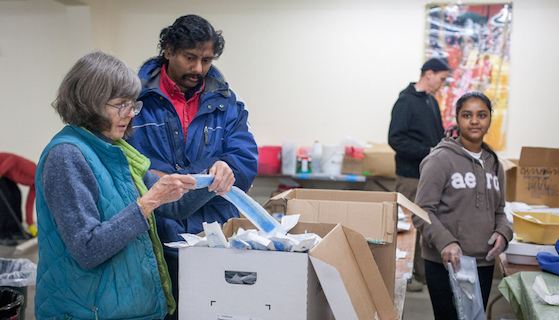 Volunteers pack shipments of new and donated medical supplies
