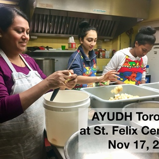 Two teens and one adult chopping potatoes at St. Felix Centre