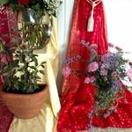 Tulsi basil and chrysanthemums on the altar