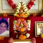 Amma's photo and Ganesh murti with fresh flower garlands