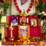 Altar with photo of Amma's feet, beautifully decorated with flowers