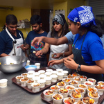 Youth making bowls of granola with peaches