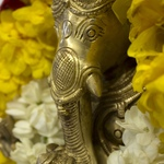 Ganesh murti with marigold and jasmine garlands