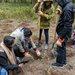 AYUDH volunteers planting trees together