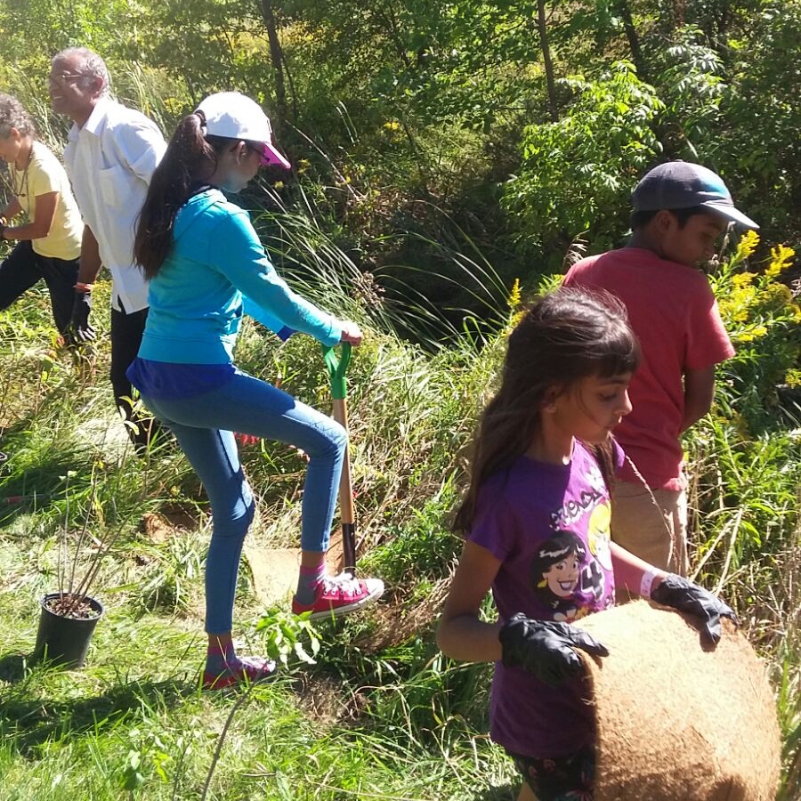 Amrita Bala Kendra kids participating in tree planting