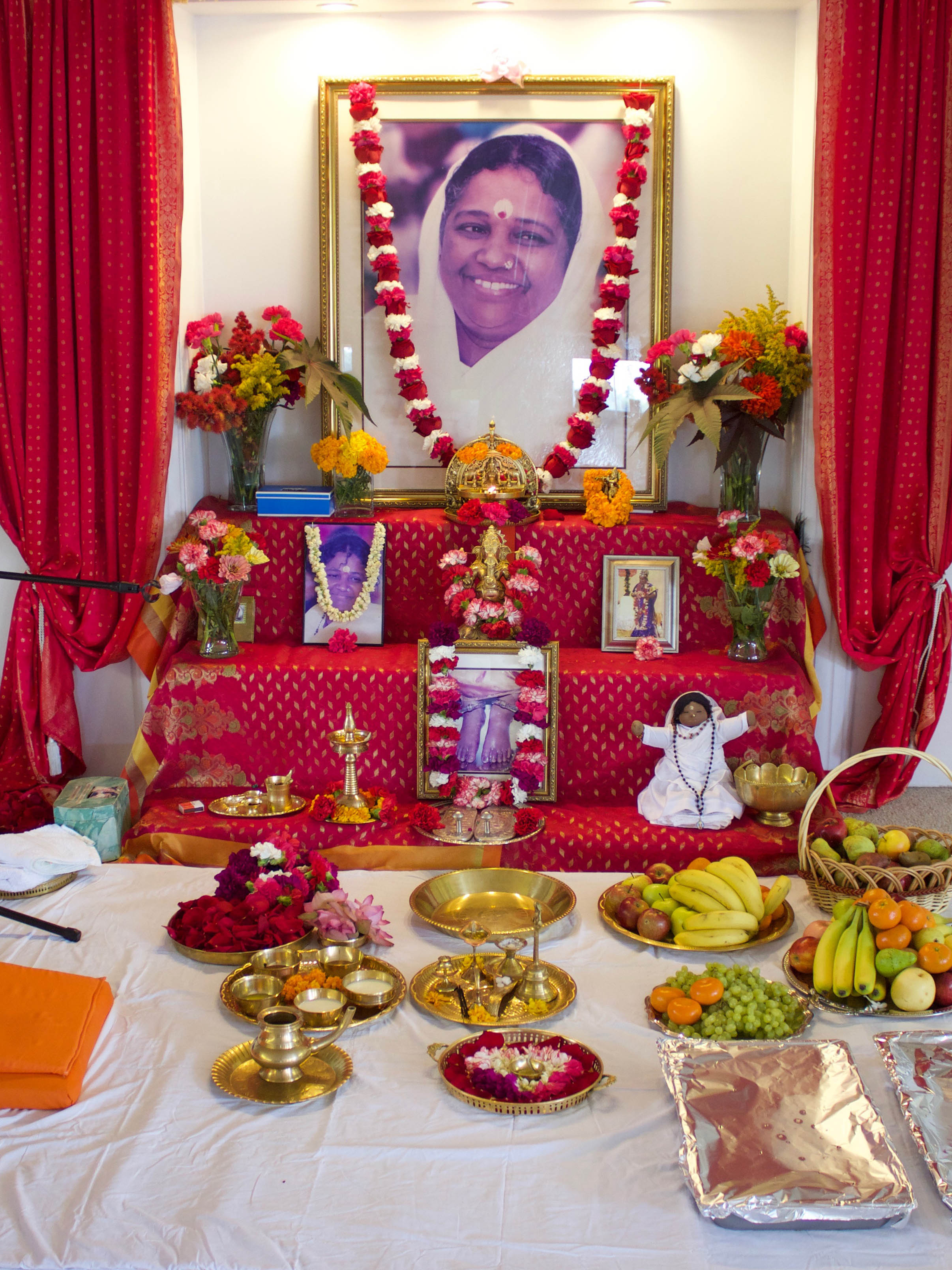 Altar with Amma's picture and garlands of fresh flowers
