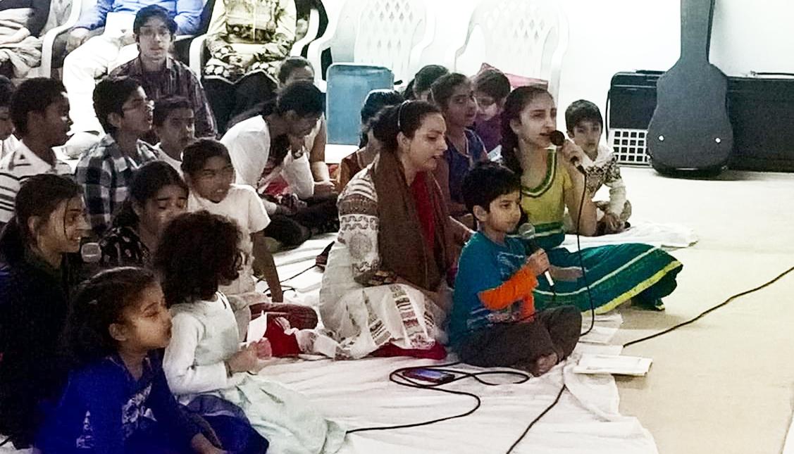 Bala Kendra children singing a bhajan together