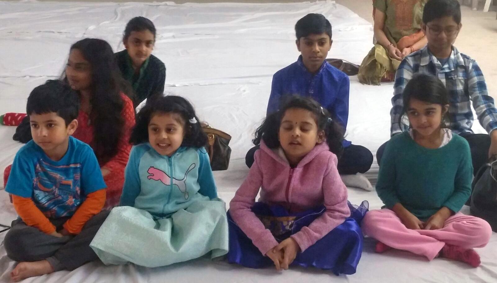 Children smiling and singing together