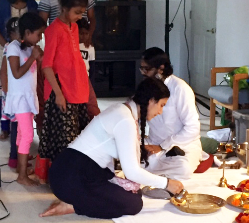 Devotees doing Guru Pada Puja