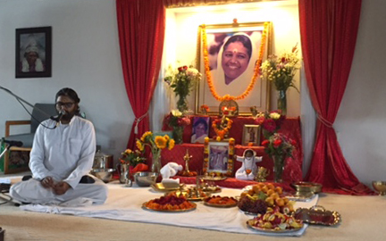 Br Ramanand beside altar