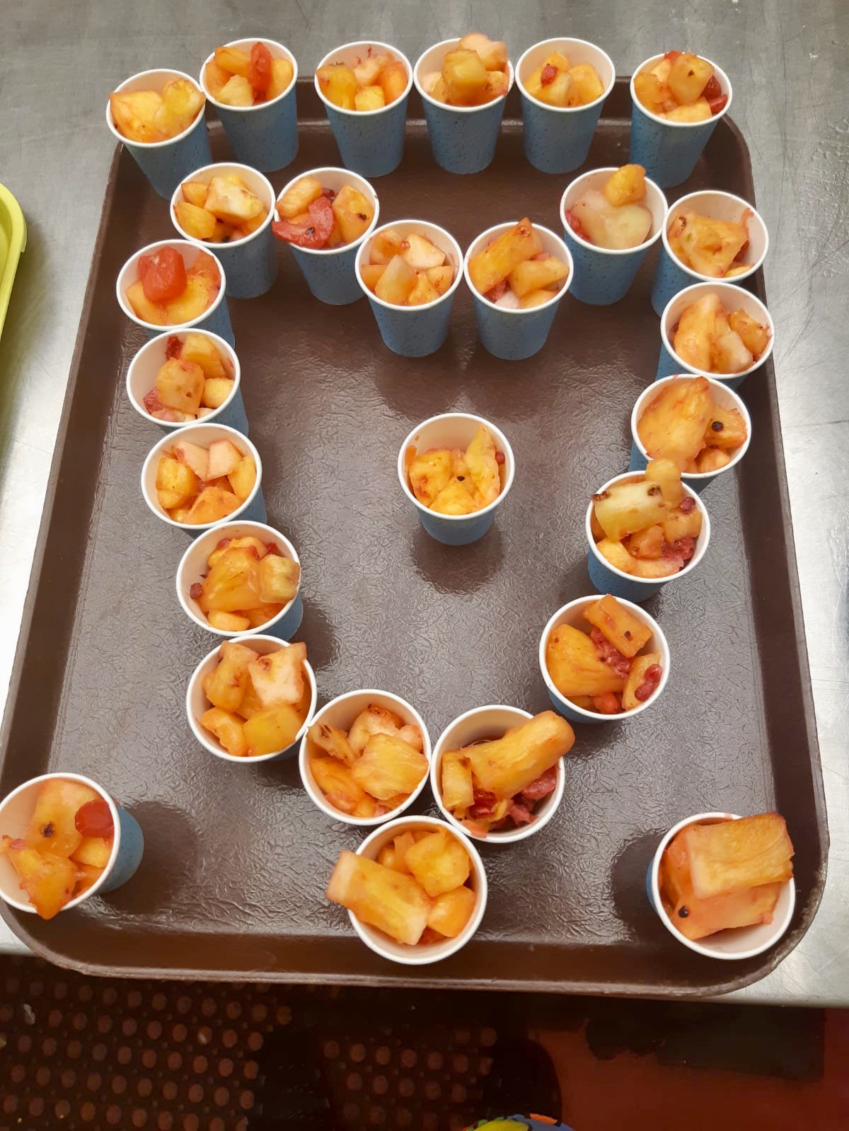 Bowls of fruit salad arranged in a heart