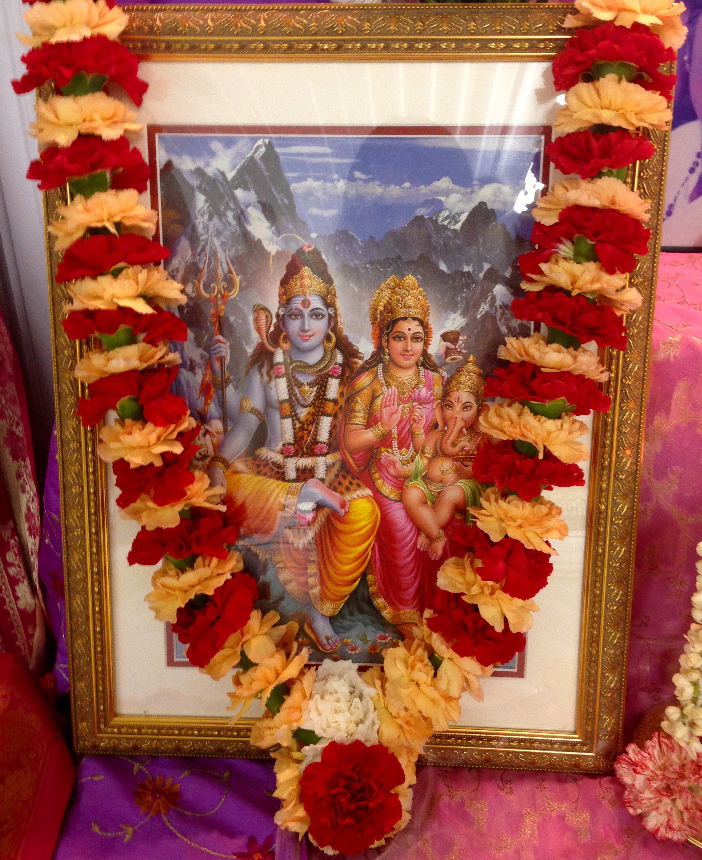 Picture of Shiva, Parvati and Ganesha with garland